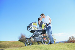 A Happy young family with little baby boy outdoors Royalty Free Stock Photos