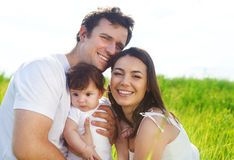 Happy young family with little baby girl Royalty Free Stock Photography