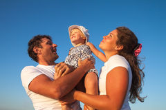 Happy Young Family with Little Child Having Fun Royalty Free Stock Photos