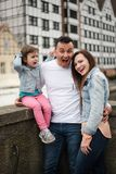 Cute little daughter and her young parents stock photography