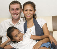 Happy young family with little girl 2 royalty free stock photos