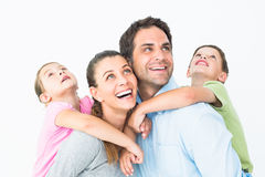 Happy young family looking up together Royalty Free Stock Image