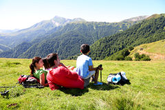 Happy young family lying in grass enjoying view Royalty Free Stock Photos