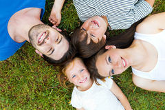 Happy young Family lying on grass Royalty Free Stock Photography