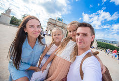 Happy young family with map of city taking selfie Stock Photo