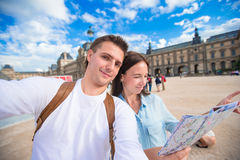 Happy young family with map of city taking selfie Royalty Free Stock Photography