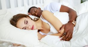 Happy family married couple sleeping in bed royalty free stock image
