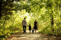 Happy young family in nature Stock Photo