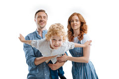 Happy young family with one child standing together royalty free stock photos