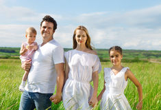 Happy young family outdoors Stock Photo