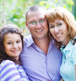 Happy young family outdoors. Happy young family with daughter outdoors Royalty Free Stock Images