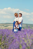 Happy young family outdoors in a lavender Royalty Free Stock Image