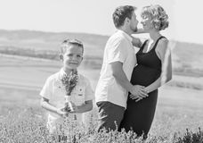 Happy young family outdoors in a lavender Royalty Free Stock Photo