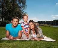 Happy young family outdoors Royalty Free Stock Images