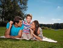 Happy young family outdoors Royalty Free Stock Photo