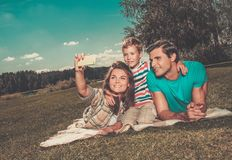 Happy young family outdoors Royalty Free Stock Photos