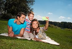 Happy young family outdoors Stock Image
