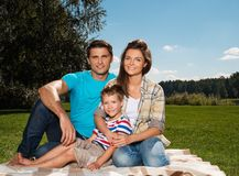 Happy young family outdoors Royalty Free Stock Image