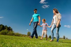 Happy young family outdoors Stock Images