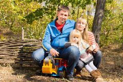 Happy young family outdoors in woodland Royalty Free Stock Image