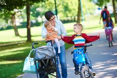 Happy young family in park Royalty Free Stock Photos