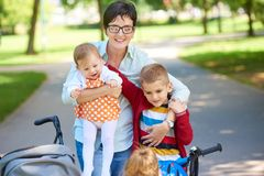 Happy young family in park Stock Image