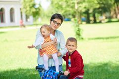Happy young family in park Royalty Free Stock Images