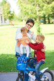 Happy young family in park Royalty Free Stock Photography