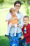 Happy young family in park Stock Photo