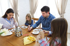 Happy young family plaing board game Royalty Free Stock Image