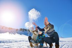 Happy young family playing in fresh snow at beautiful sunny winter day outdoor in nature Stock Images