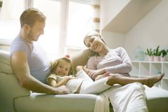 Happy young family playing at home. royalty free stock photo
