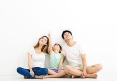 Happy  Young  Family pointing and looking up Stock Photo