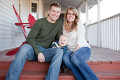 Happy Young Family on Porch Royalty Free Stock Photo