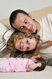 Happy young family portrait Stock Photos