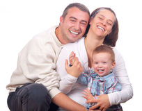 Happy young family posing Royalty Free Stock Photography