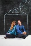 Happy young family posing in house drawn on chalkboard Stock Photos