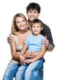 Happy young family with pretty child Royalty Free Stock Photos