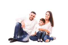 Happy young family with pretty child posing Royalty Free Stock Photos