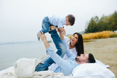 Happy young family relaxing together on the lake royalty free stock image