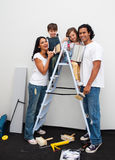 Happy young family renovating a room Royalty Free Stock Images