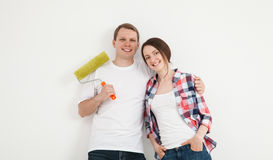 Happy young family repairing a new flat Stock Photos