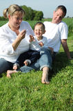 Happy young family with small child Royalty Free Stock Photography