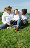 Happy young family with small child Stock Photos