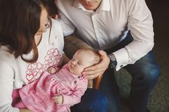 Happy young family with a small child in her arms. Royalty Free Stock Photos