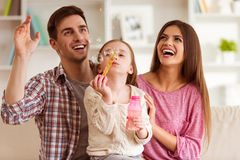 Happy young family Stock Photos