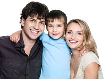 Happy young family with smiling son stock images