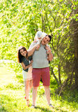 Happy young family spending time outdoor on a summer day.  royalty free stock photos