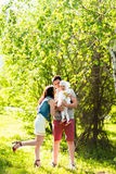 Happy young family spending time outdoor on a summer day.  stock photos