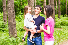 Happy young family spending time outdoor on a summer day.  stock photography